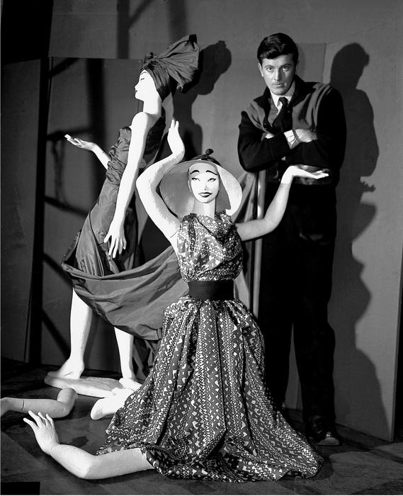 """FILE - In this Feb.1 1952 file photo, French fashion designer Hubert de Givenchy poses with mannequins in his shop in Paris. French couturier Hubert de Givenchy, a pioneer of ready-to-wear who designed Audrey Hepburn's little black dress in """"Breakfast at Tiffany's,"""" has died at the age of 91. (ANSA/AP Photo, File) [CopyrightNotice: AP1952]"""