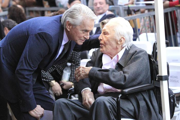 epa07147001 US actor Michael Douglas (L) talks to his father, actor Kirk Douglas during a ceremony honoring him with a star on the Hollywood Walk of Fame in Hollywood, California, USA, 06 November 2018. Douglas received the 2,648th star in the Motion Pictures category.  EPA/NINA PROMMER
