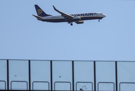 epa07059095 A Ryanair plane fly over Commerzbank Arena in Frankfurt Main, Germany, 30 September 2018. In the last days Ryanair cabin crews in Belgium, Germany, Italy, the Netherlands, Portugal and Spain have also gone on strike in a row over contracts and conditions, with unions demanding that staff be hired under contracts in the countries where they are based instead of under Irish law.  EPA/ARMANDO BABANI