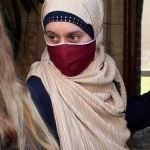 Italian aid worker, Silvia Romano, wearing a Somali garb and face mask, covers her face leaving a beauty center, at the end of her compulsory quarantine in Milan, Italy, 25 May 2020. The beauty centeris the first destination chosen by Silvia Romano at the end of the 14-day quarantine, taken when she returned home to Milan on 11 May after being kidnapped for a year and a half between Kenya and Somalia. ANSA/MATTEO BAZZI